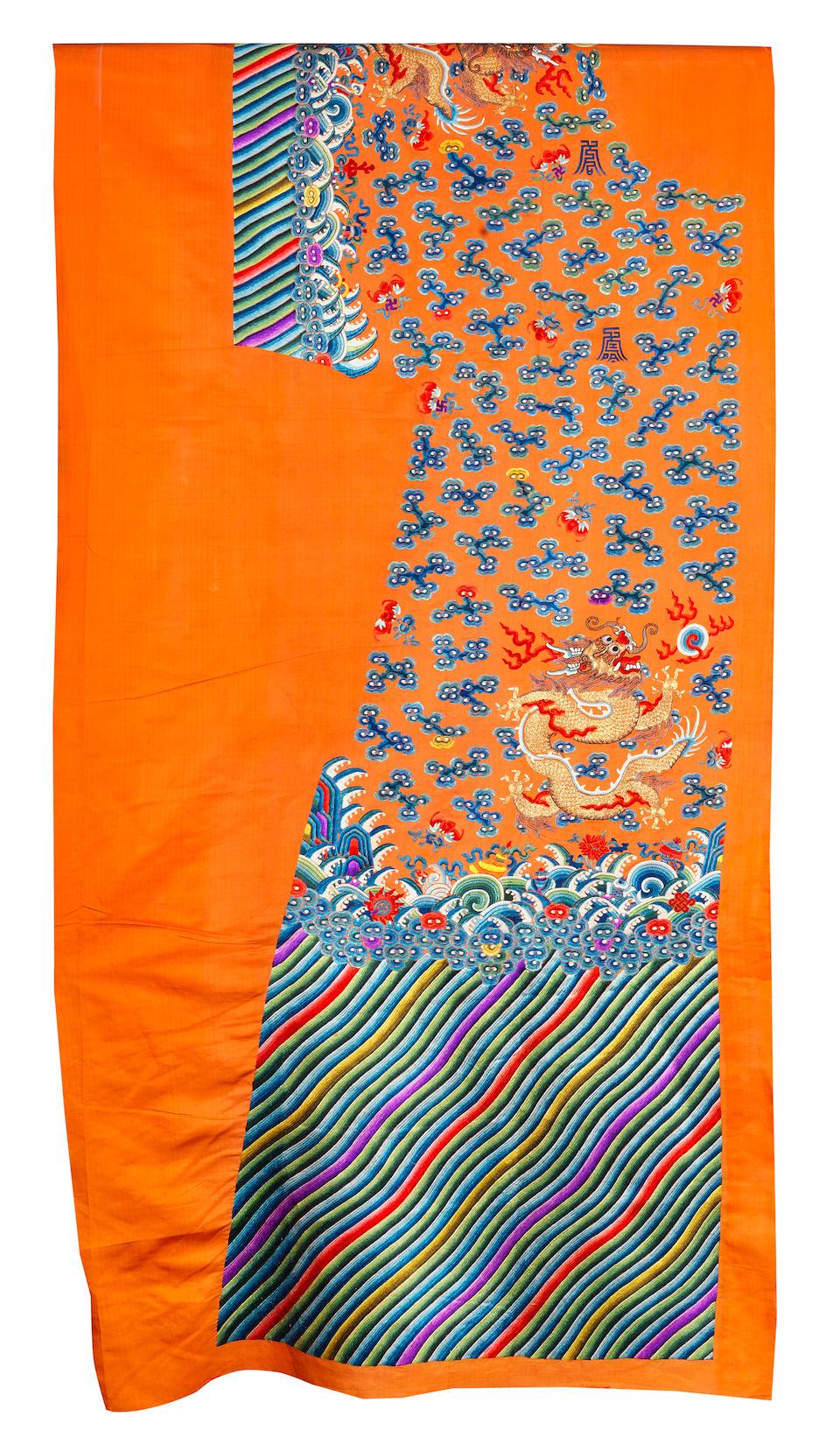 An uncut silk 'Twelve Symbols' apricot yellow-ground robe Late 19th century