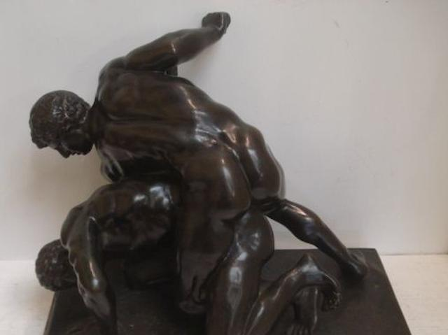 A late 19th Century German patinated bronze group of two nude wrestlers, after the antique, on a rectangular base, inscribed 'H.S., Munchen', and on a rectangular marble plinth, the bronze 46cm wide x 37cm high.