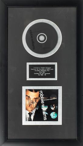 A Platinum award for the album I've Been Expecting You, Denmark, circa 1998,