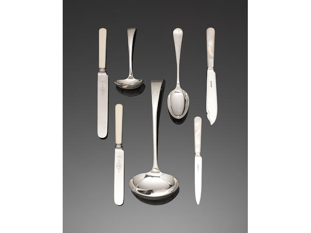 An extensive silver Old English pattern table service of flatware and cutlery, contained in a table cabinet by E Viner, Sheffield 1931 - 1936