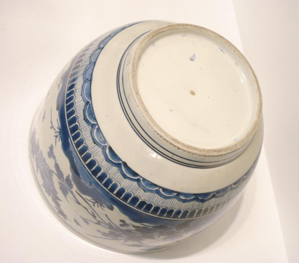 A large blue and white vessel and a Chinese brush pot Circa 1700
