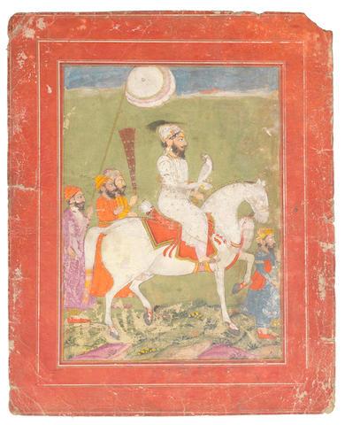 The Sikh Guru Govind Singh (1666-1708) on horseback with attendants North India, early 19th Century