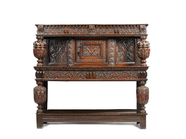 A fine James I oak and elm joined standing livery cupboard, West Country, possibly Gloucestershire, circa 1620