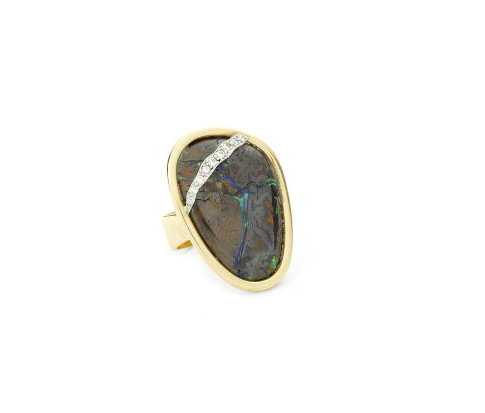 An 18 carat gold, wood opal and diamond pendant/necklace and ring, by Andrew Grima,