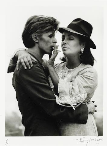 David Bowie & Elizabeth Taylor: Terry O'Neill (British, b. 1938) gelatin silver print, Beverly Hills, 1975,