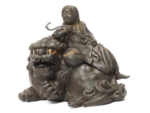 An iron okimono figure of Monju Bosatsu  By Unno Shomin (1844-1915), late Edo Period (3)