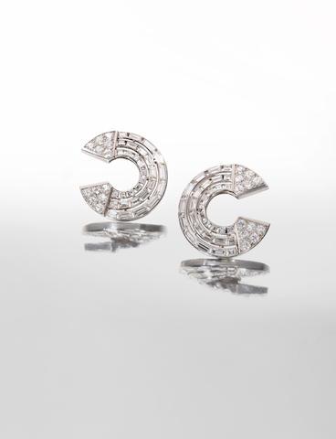 A pair of diamond earclips,