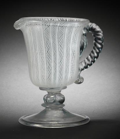 An important early latticinio jug, probably English, circa 1675