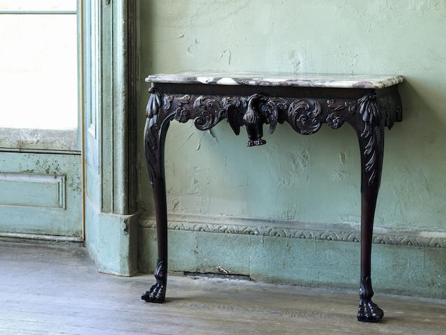 An Irish George II carved mahogany console table