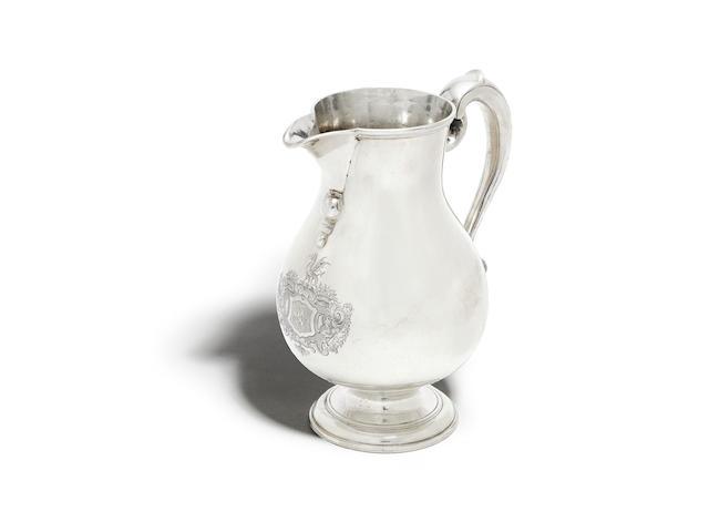 A George I silver ale jug by Arnett & Pocock, London 1723