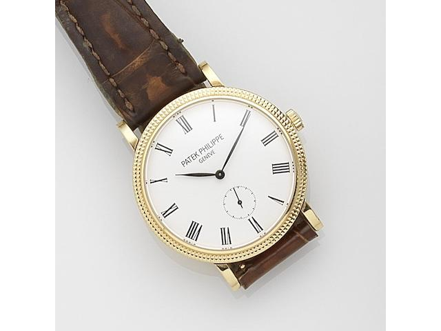 Patek Philippe. A mid-size 18ct gold manual wind wristwatch Calatrava, Ref:7119J/010, Movement No.5562449, Sold 2012