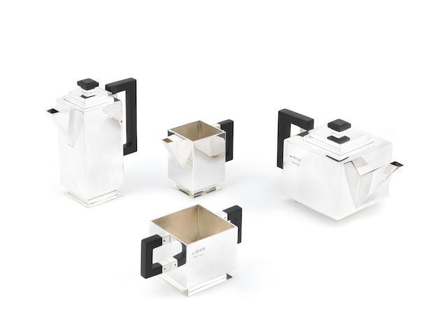 CHARLES BOYTON: An impressive art deco 'Cube' design four-piece tea and coffee service also with facsimile signature, London 1938  (4)