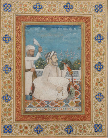 A teacher, perhaps a certain Bhawani Das Bakhawji, seated on a terrace smoking a hookah, an attendant standing behind Delhi, mid-19th Century