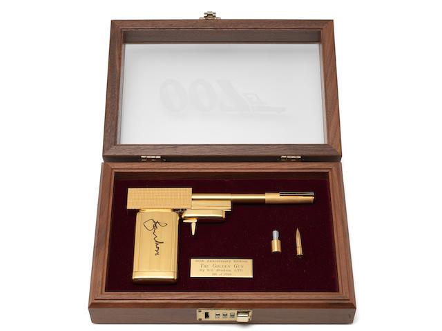 James Bond / The Man With The Golden Gun: A SD studios replica gun signed by Roger Moore,