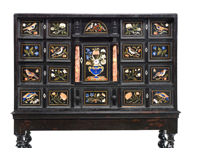 A Florentine pietre dure, ebony and ebonised cabinet on stand the pietre dure panels by the Grand Ducal workshops, largely 17th and 18th century, the cabinet arrangement 19th century