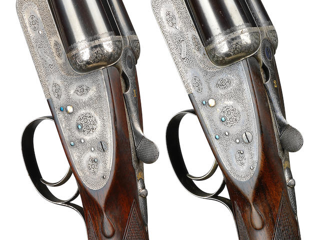 A fine pair of 12-bore single-trigger easy-opening sidelock ejector guns by Boss & Co., no. 6673/4 In their brass-mounted oak and leather case