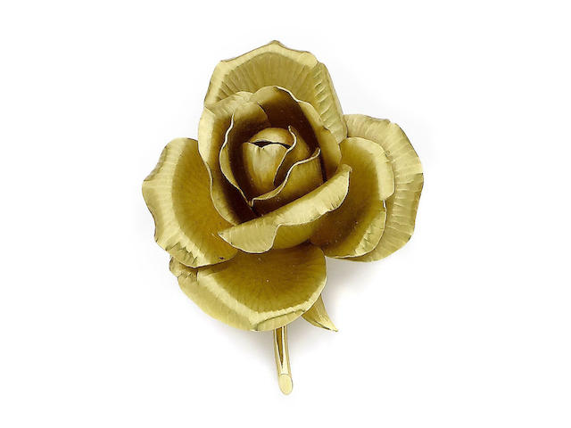 A gold rose brooch, by Cartier,