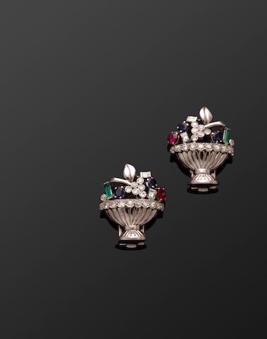 A pair of diamond and vari gem-set earclips