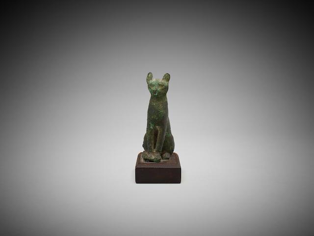 An Egyptian bronze cat, circa 664-332 B.C.