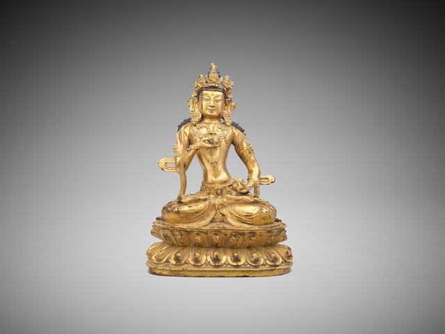 A gilt-bronze figure of Vajrasttva