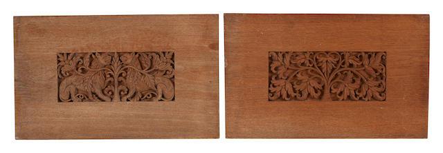 Two carved teakwood panels