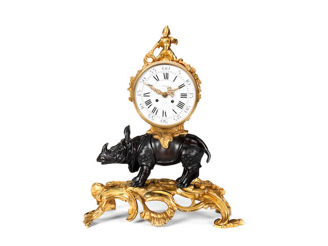 A gilt and patinated bronze mantel clock with bronze rhinoceros in the Louis XV style, the dial signed Goudain A Paris