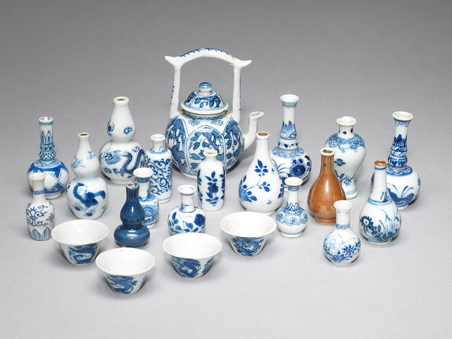 A rare blue and white miniature teapot and cover, four tea bowls and a collection of 'doll's house' porcelain Kangxi and later (22)