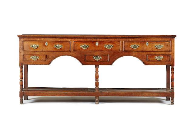 An early 19th century oak pot-board low dresser, Carmarthenshire, circa 1820 - 50