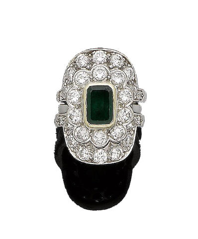 An emerald and diamond cluster ring and adjoining diamond rings
