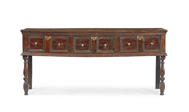 An oak low open dresser, English, circa 1700
