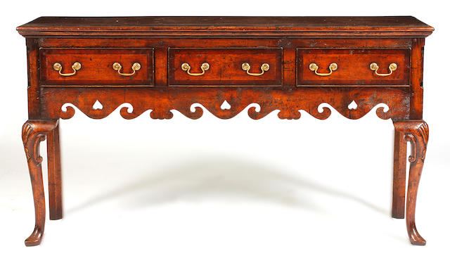An 18th Century oak and crossbanded low dresser,