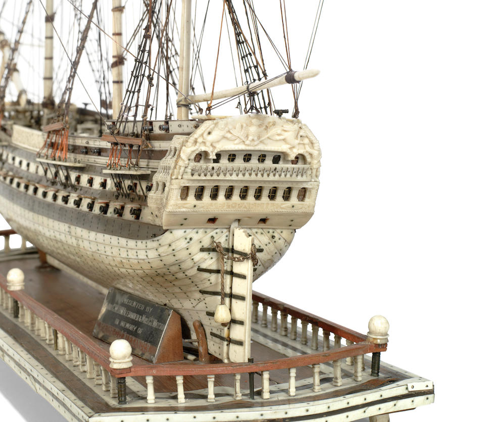 A Napoleonic prisoner-of-war model of the 80-gun ship-of-the-line 'Sans Pariel', early 19th Century,  22 x 28 x 7in (56 x 71 x 18cm). Outer case: 34 x 14 25 1/2in (86 x 35 65cm)