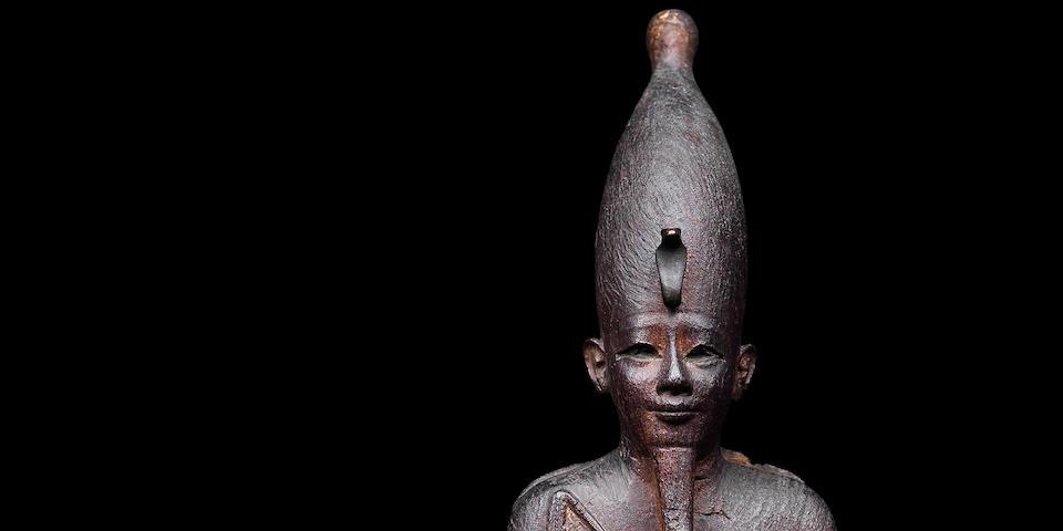 A large Egyptian wood figure of Osiris
