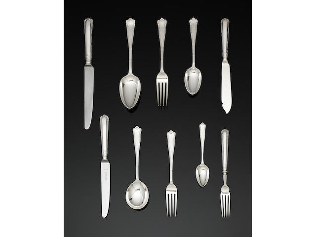 A silver Marie pattern table service of flatware and cutlery by Garrard& Co Ltd, London 1964 - 1976, some cutley also by C J Vander Ltd, Sheffield 1964 - 1977