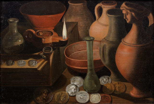 German School, 17th Century Ancient coins, glasswear and pots on a table-top with an oil lamp