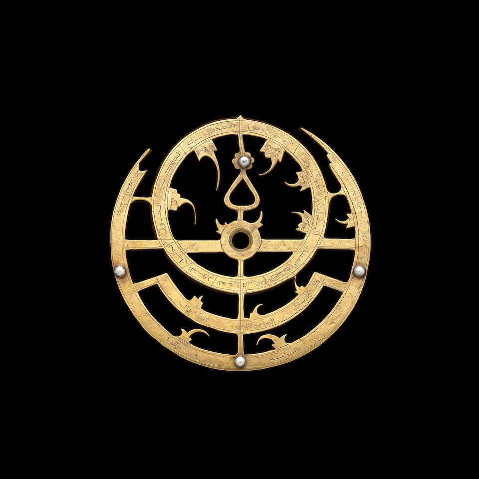 A small brass copy of a 16th century Ottoman astrolabe,