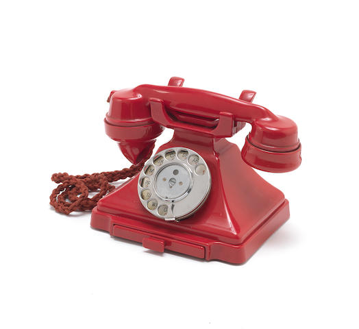 A 232CB red bakelite telephone,