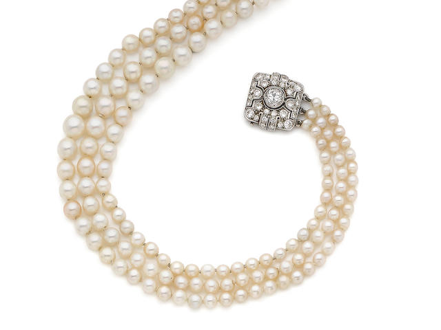 A three-row pearl necklace with diamond clasp,