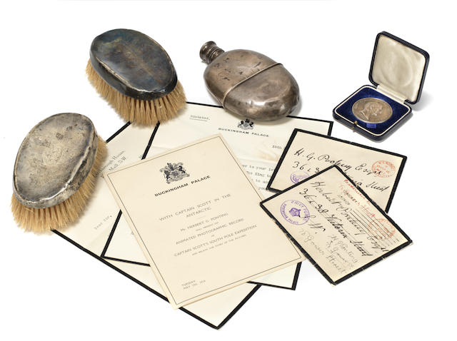 BRITISH ANTARCTIC EXPEDITION 1910-1913 A collection of ephemera relating to Herbert George Ponting, comprising an Emerson medal for photography, silver-backed brushes and correspondence with the Royal Household, c.1910-1929