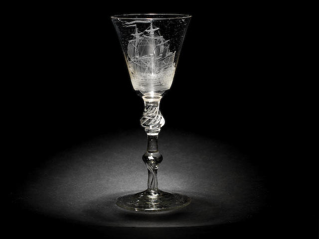 An important Dutch engraved light baluster wine glass signed by Jacob Sang, dated 1757 and 1761