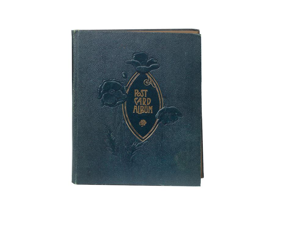 An album of Edwardian motoring postcards,