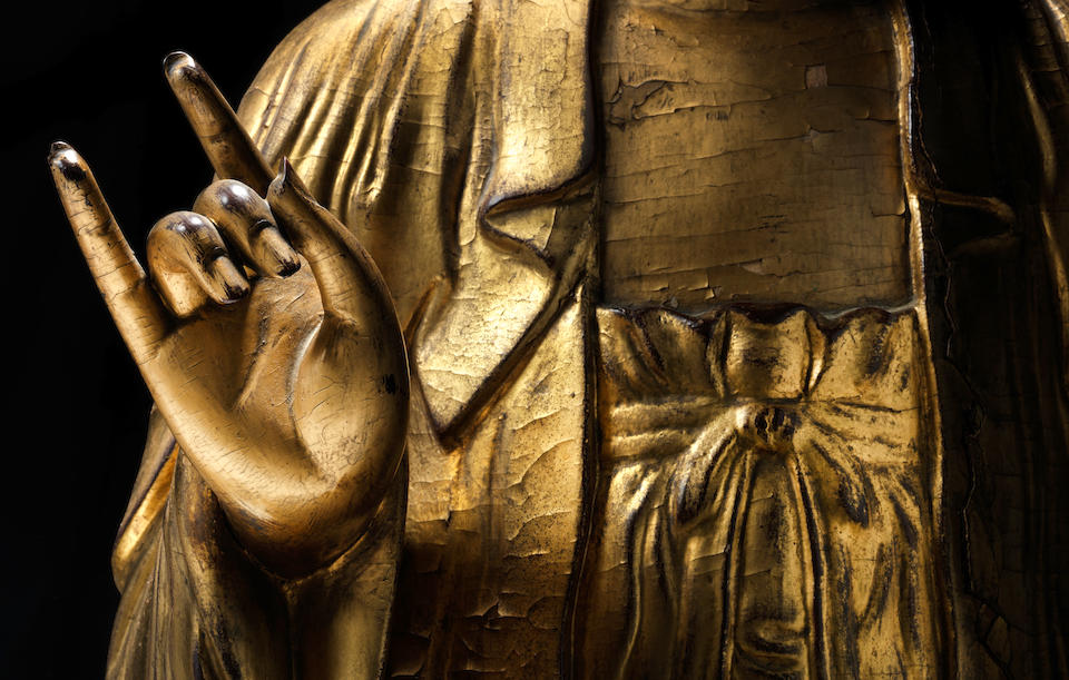 A rare and large gilt-lacquered wood figure of Buddha 17th/18th century