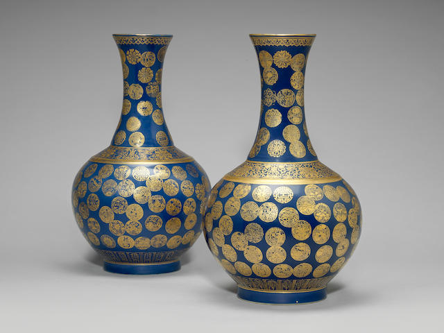 A near pair of powder-blue and gilt 'medallion' bottle vases, shangping Guangxu six-character marks and of the period (2)