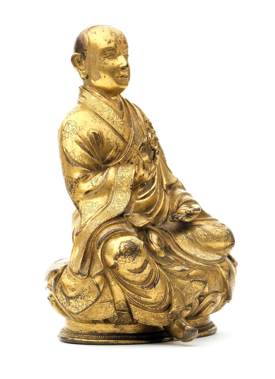 A rare inscribed gilt-copper alloy figure of arhat Bhadra Tibet, 17th century