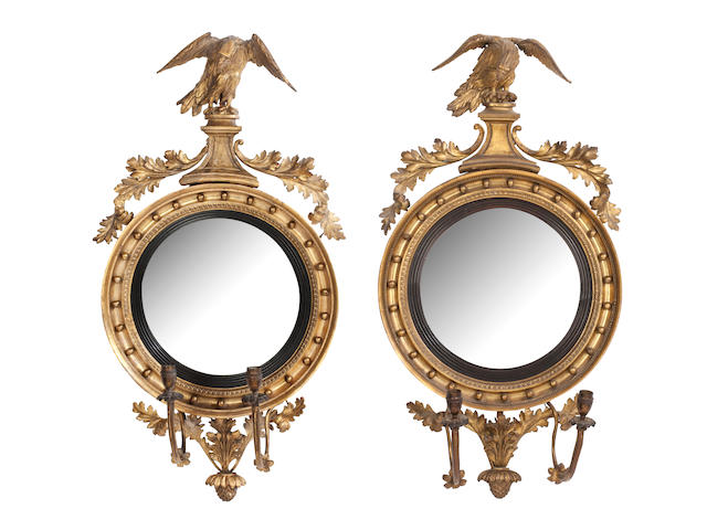 A pair of Regency carved giltwood and gesso convex mirrors (2)