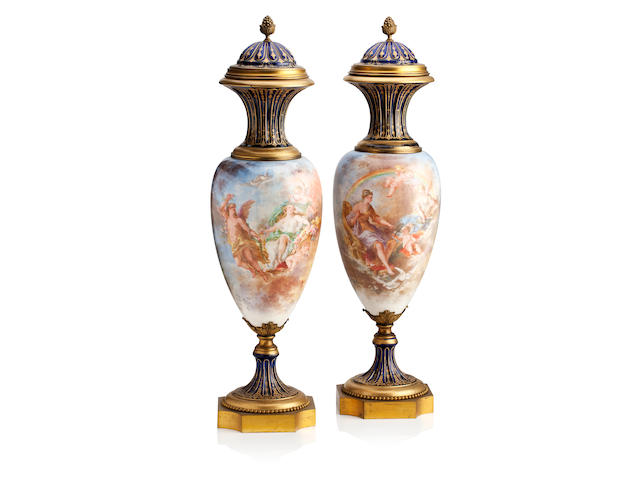 A pair of large Continental vases with covers