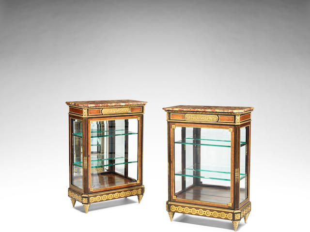 A pair of French late 19th century gilt-bronze mounted kingwood, tulipwood and amaranth vitrine cabinets (2)