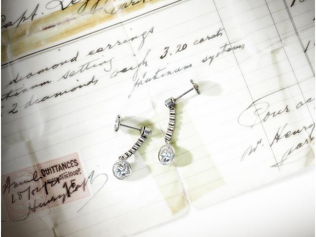A pair of art deco diamond pendent earrings,