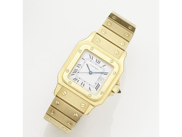Cartier. An 18K gold automatic calendar bracelet watch together with associated cuff links Santos, Circa 1990