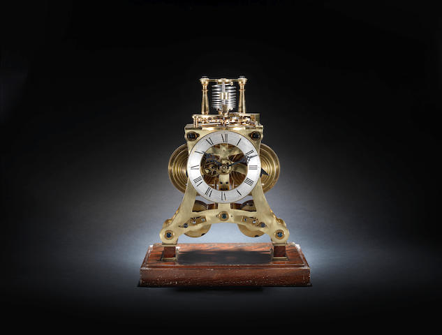 A fine 20th century skeleton clock with twin fusees and Hardy's chronometer escapement